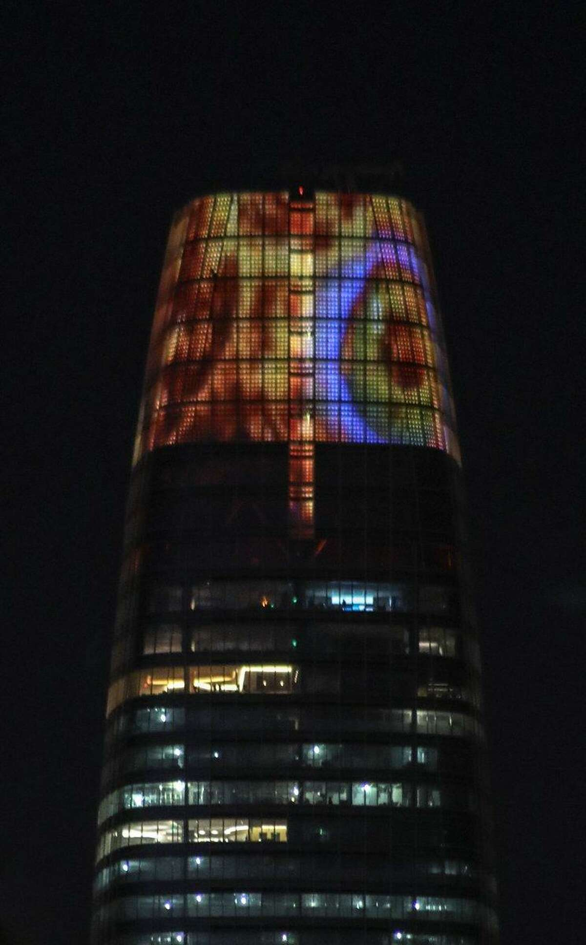 Salesforce Tower's crown lights up to reflect the giant fiery Eye of Sauron after a petition to transform the installation into the fantasy antagonist from J. R. R. Tolkien novels garnered more than 11,000 signatures on Change.org.