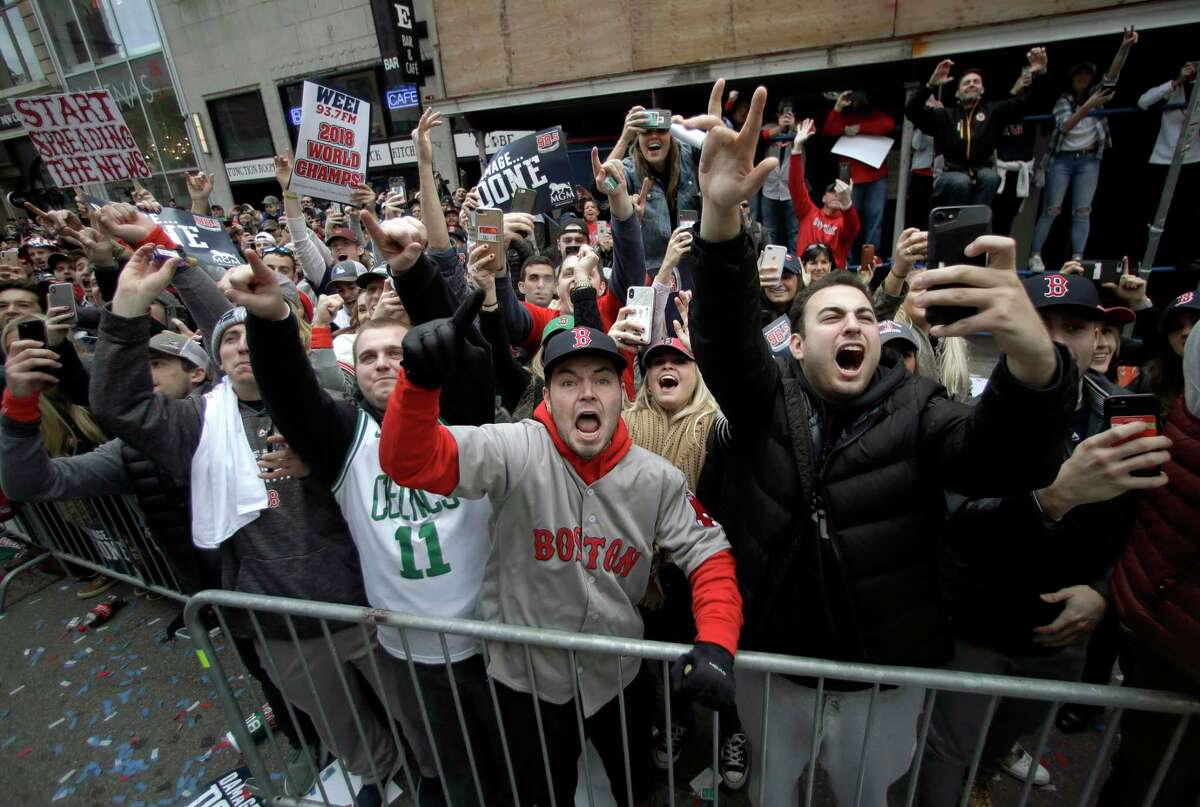 Boston Red Sox fans cheer during a parade to celebrate the team's World Series championship over the Los Angeles Dodgers, Wednesday, Oct. 31, 2018, in Boston. (AP Photo/Charles Krupa)