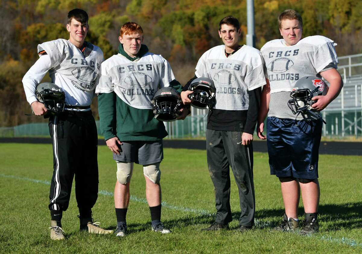 Cobleskill-Richmondville football players, from left, Donovan Pacatte,Hunter Edwards, Stephen Maniscalco and Spencer Lindstead are seen at practice on Tuesday, Oct. 30, 2018 in Cobleskill, N.Y. (Lori Van Buren/Times Union)