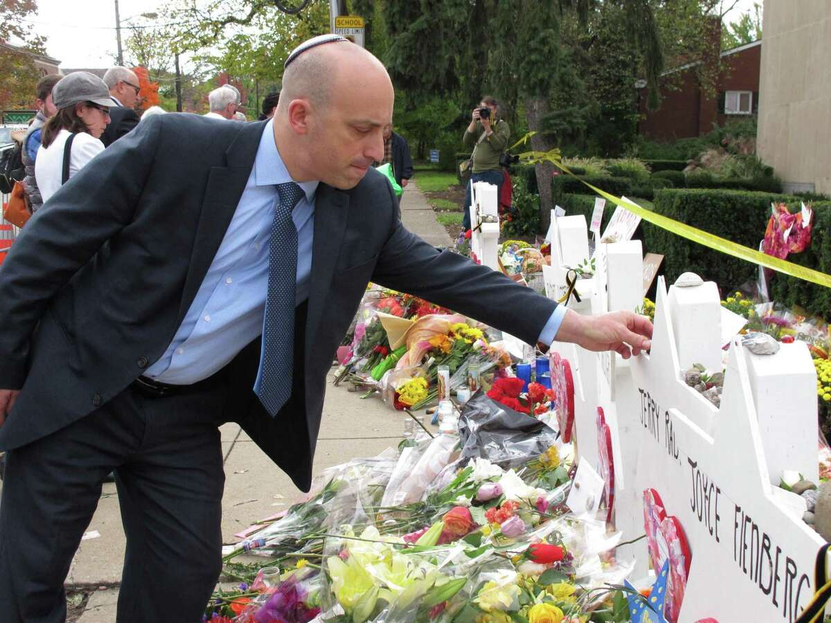 Jonathan Greenblatt, CEO and national director of the Anti-Defamation League, places a stone on the Star of David for Dr. Jerry Rabinowitz at Tree of Life synagogue in Pittsburgh on Wednesday, Oct. 31, 2018. Greenblatt flew in for the funerals of victims of Saturday's mass shooting at Tree of Life, which left 11 dead and six injured. He said President Trump was right to call the massacre an act of anti-Semitism, but he said Trump's words and actions in coming weeks and months will be the test of his sincerity.
