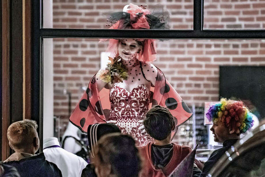 From the living mannequins in the windows of Frew's Bridal, to bands, to fans of frights, the century-old Alton Halloween didn't disappoint Thursday night. Here's the scene from Third Street and Piasa.