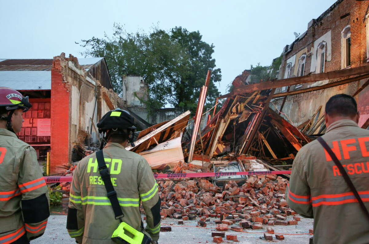 Houston Fire Department firefighters at the scene where a building collapsed on Congress Avenue near Bastrop Street Thursday, Nov. 1, 2018, in Houston.