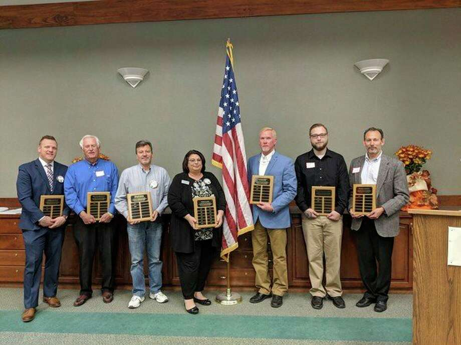 Kiwanis Gold Level Sponsorship plaque recipients pictured are, from left, Nick Krattiger, Garber Chevrolet, Jim Wilson, Midland Ford Lincoln, Alex Rapanos, Midland Towne Center, LeeAnn Kerns, Chemical Bank, Jay Brown, Valley Electric, Ryan Boshaw, Midland Brewing Company, Jesse Traschen, Bolger & Battle. Not pictured are Jamie Brown, Midland Sprinklers, Mark Cadotte, DDS, and representatives from Maier & Associates, White IEQ Consulting, Eastman Party Store, and XALT Energy.