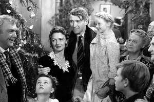 """James Stewart, Donna Reed, Beulah Bondi, and Thomas Mitchell in """"It's a Wonderful Life"""""""