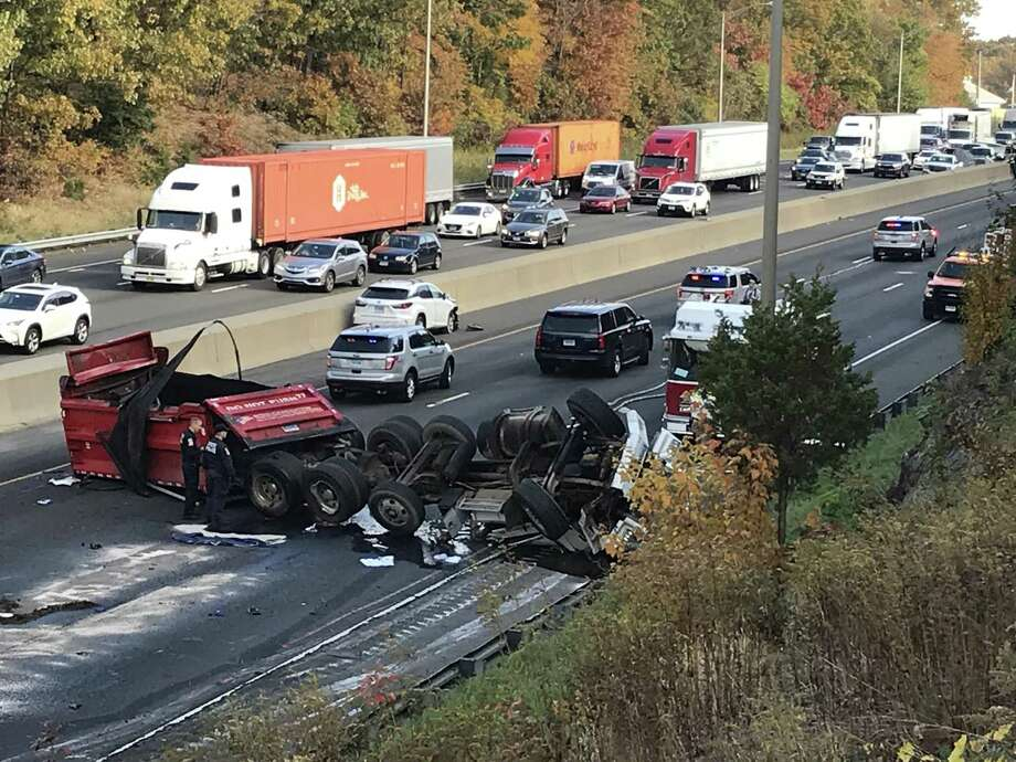 A dump truck with its rear box bed raised slammed into a bridge on I-95, killing the driver and closing down the northbound highway for hours in Milford on Thursday, Nov. 1, 2018. Photo: Brian Pounds /Hearst Connecticut Media