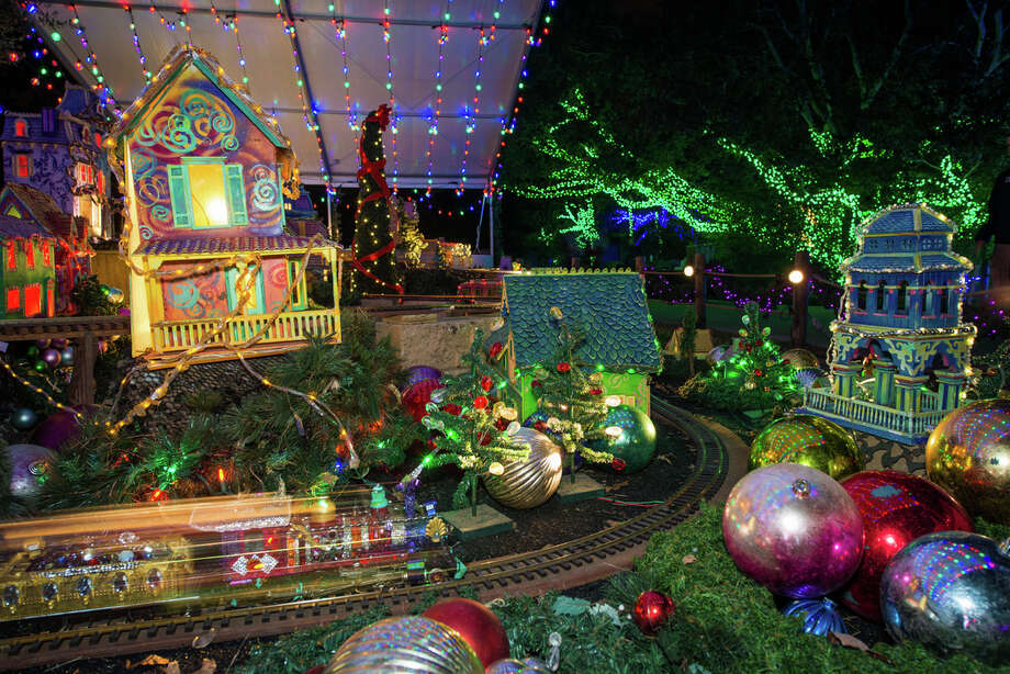 The Houston Zoo's annual Zoo Lights attraction kicks off on Nov. 17 and runs through Jan. 13. According to the zoo nearly 15 miles of LED lights are used to create the holiday scenes. Photo: Stephanie Adams /Houston Zoo