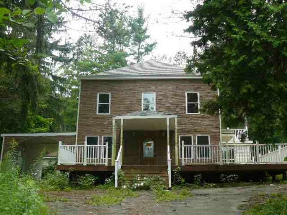 A 2009 photo from a real estate listing of the former Loudonville home of Shahed Hussain, who was working as an FBI informant at the time. The original home suffered significant damage from a 2003 fire and was partially rebuilt, although it never passed inspection for a certificate of occupancy. The current owners demolished the structure in 2010, and the lot remains vacant.