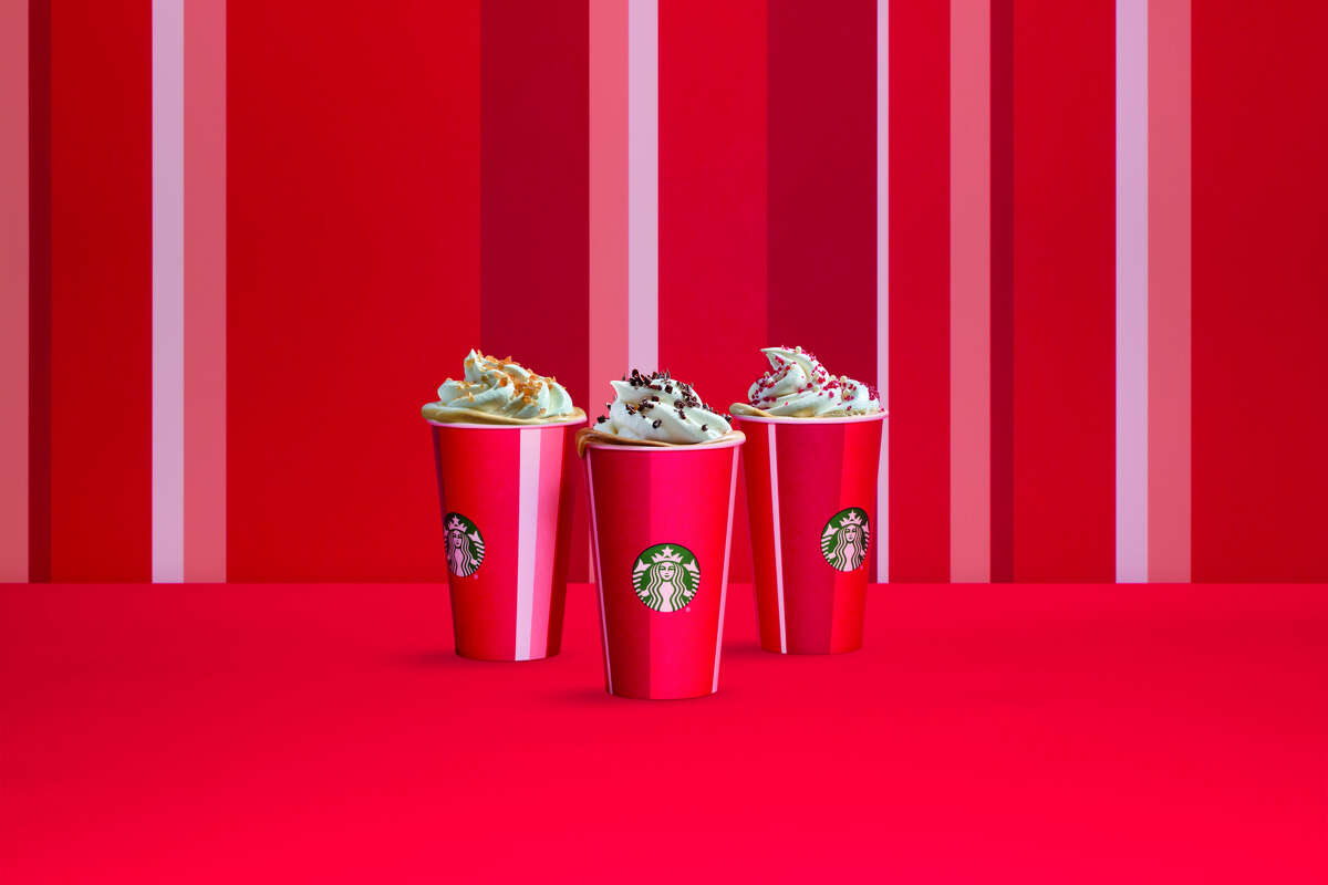 The Stripes holiday cup has vertical bands of bright poppy red, dark cranberry red, and white pale rose gold.