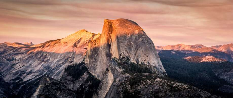 Sunset over the famous Half Dome in Yosemite. Photo: REDA&CO/UIG Via Getty Images