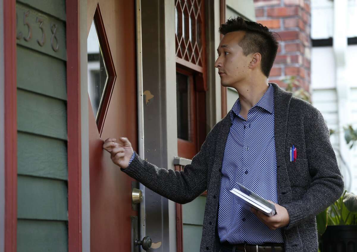 Rigel Robinson, a candidate running for the Berkeley City Council District 7 seat, knocks on doors while canvassing a neighborhood in Berkeley, Calif. on Saturday, Oct. 27, 2018.