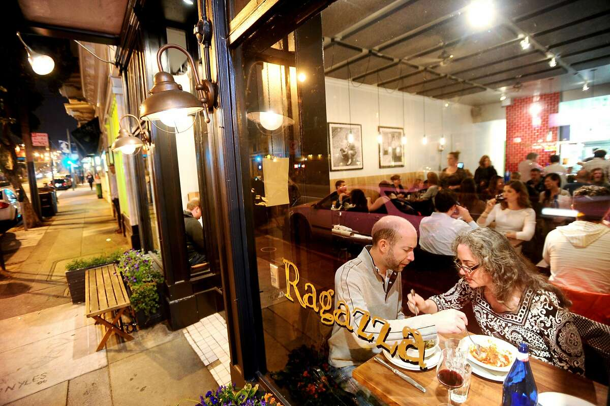 Erin McCune and Nick Virene sample each other's dishes at Ragazza .