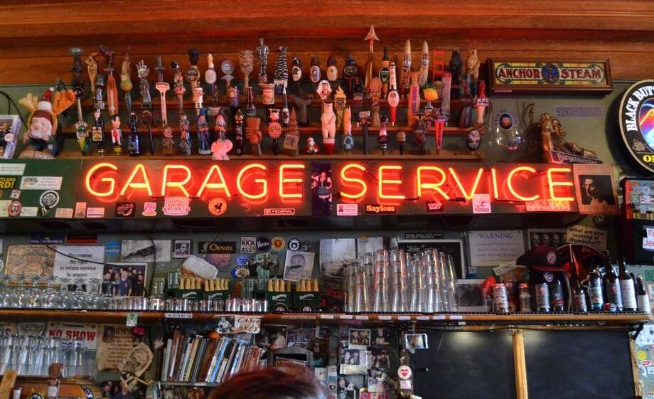 "The famed ""Garage Service"" sign at Toronado on Haight Street on October 31, 2018. Photo: Alyssa Pereira/SFGATE"