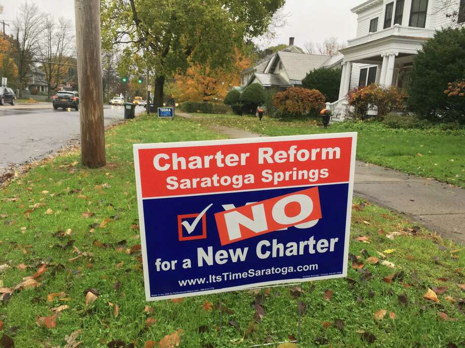 Signs are popping up around Saratoga Springs in an effort to persuade voters on the 2018 charter referendum. Photo: Wendy Liberatore/Times Union