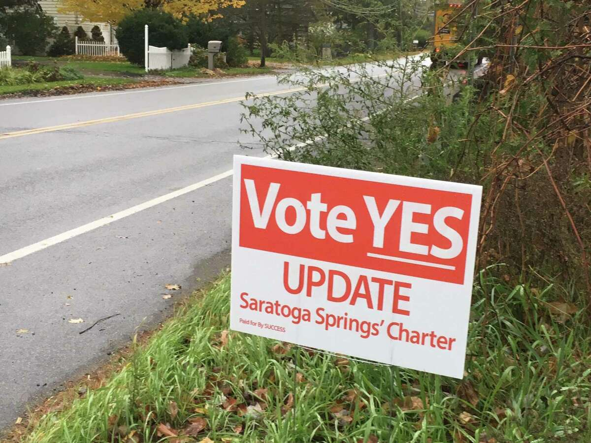 Signs are popping up around Saratoga Springs in an effort to persuade voters on the 2018 charter referendum.