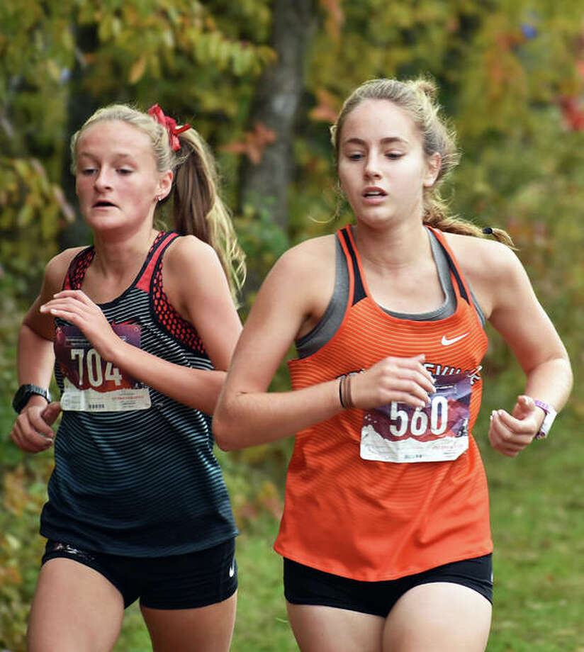 Edwardsville's Hannah Stuart, right, completes the first mile of the Class 3A Quincy Sectional. Photo: Matt Kamp/Intelligencer
