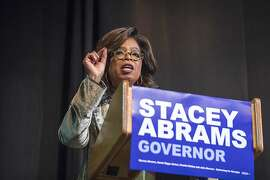Oprah Winfrey speaks to a crowd during a town hall conversation for gubernatorial candidate Stacey Abrams at the Cobb Civic Center's Jennie T. Anderson Theatre in Marietta, Ga., Thursday, Nov. 1, 2018. Winfrey visited Georgia on Thursday to canvass neighborhoods in Metro Atlanta and show her support for gubernatorial candidate Stacey Abrams. (Alyssa Pointer /Atlanta Journal-Constitution via AP)
