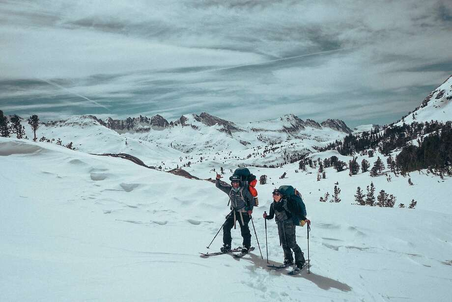 """Snowboarders Jeremy Jones (left) and Elena Hight in the Eastern Sierra during the filming of """"Ode to Muir."""" Photo: Courtesy Teton Gravity Research / Nick Kalisz"""