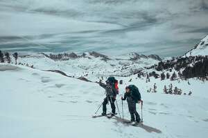 "Snowboarders Jeremy Jones (left) and Elena Hight in the Eastern Sierra during the filming of ""Ode to Muir."""