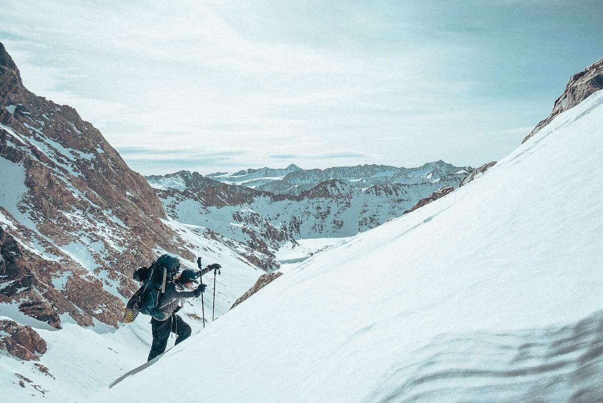 Snowboarder Jeremy Jones trekking in the Eastern Sierra during the filming of
