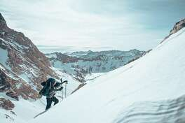 """Snowboarder Jeremy Jones trekking in the Eastern Sierra during the filming of """"Ode to Muir."""""""