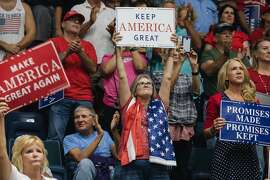 Supporters holds placards as U.S. President Donald Trump, not pictured, speaks during a campaign rally in Estero, Florida, U.S., on Wednesday, Oct. 31, 2018. Trump doubled down on his vow to deny U.S. citizenship to children born of unauthorized immigrants as he kicked off an eleventh-hour effort to save Republican control of the Senate. Photographer: Jayme Gershen/Bloomberg