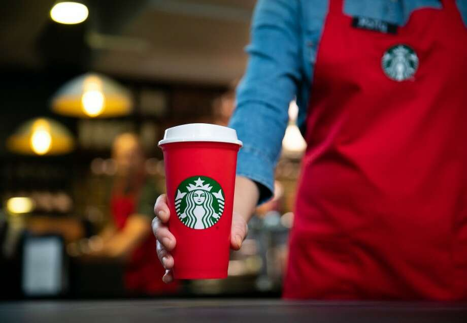 A limited edition reusable red cup will be given away for free to customers who purchase a holiday drink on Nov. 2. They will be available to purchase for $2.50 on Nov. 3 while supplies last. Photo: Courtesy Starbucks