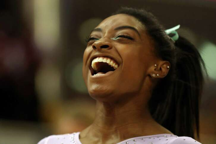 DOHA, QATAR - NOVEMBER 01: Simone Biles of the United States celebrates after winning Women's All-Around Final during Day Eight of 2018 FIG Artistic Gymnastics Championships at Aspire Dome on November 1, 2018 in Doha, Qatar. (Photo by Francois Nel/Getty Images)