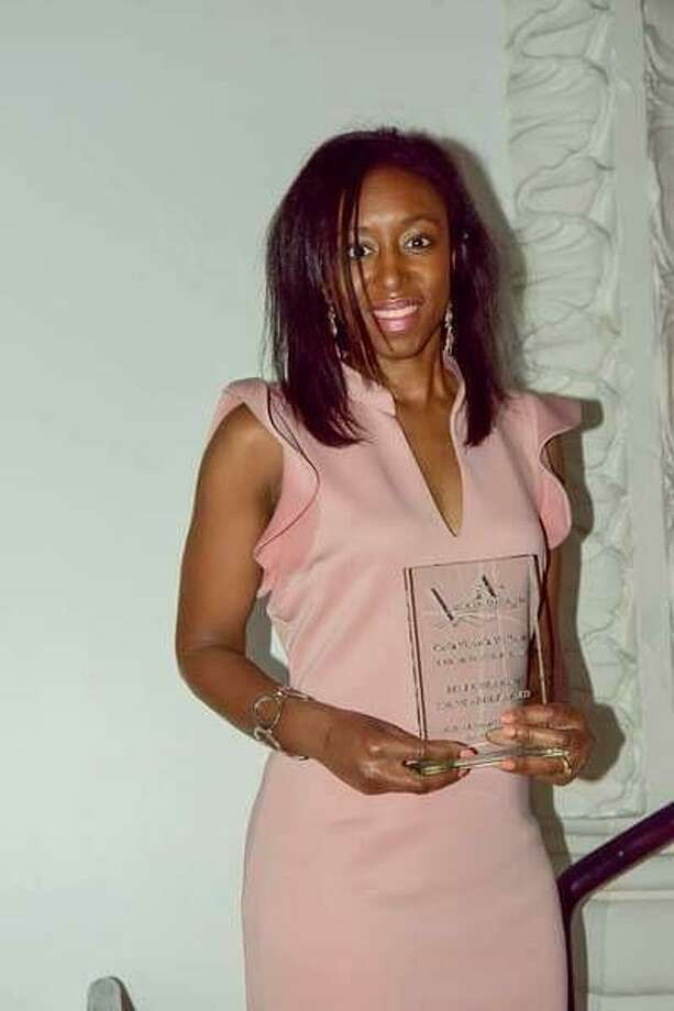 Carla Victoria Wallace accepts an African American Literary Awards Show prize this month. Photo: Contributed Photo