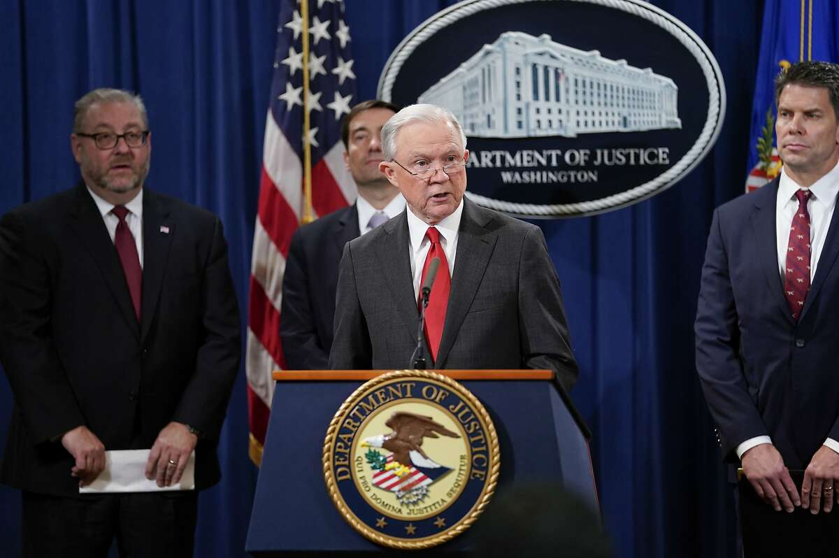 Attorney General Jeff Sessions, center, speaks during a news conference to announce a criminal law enforcement action involving China, at the Department of Justice in Washington, Thursday, Nov. 1, 2018. With Sessions are from l-r., Assistant Attorney General for the Criminal Division Brian A. Benczkowski, Assistant Attorney General for National Security John C. Demers and FBI Deputy Director David L. Bowdich. (AP Photo/Pablo Martinez Monsivais)