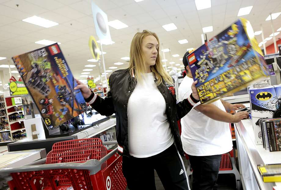 Brittany Williams of Houston checks out at Target with gifts she bought on Black Friday, Nov. 24, 2017, in Houston.