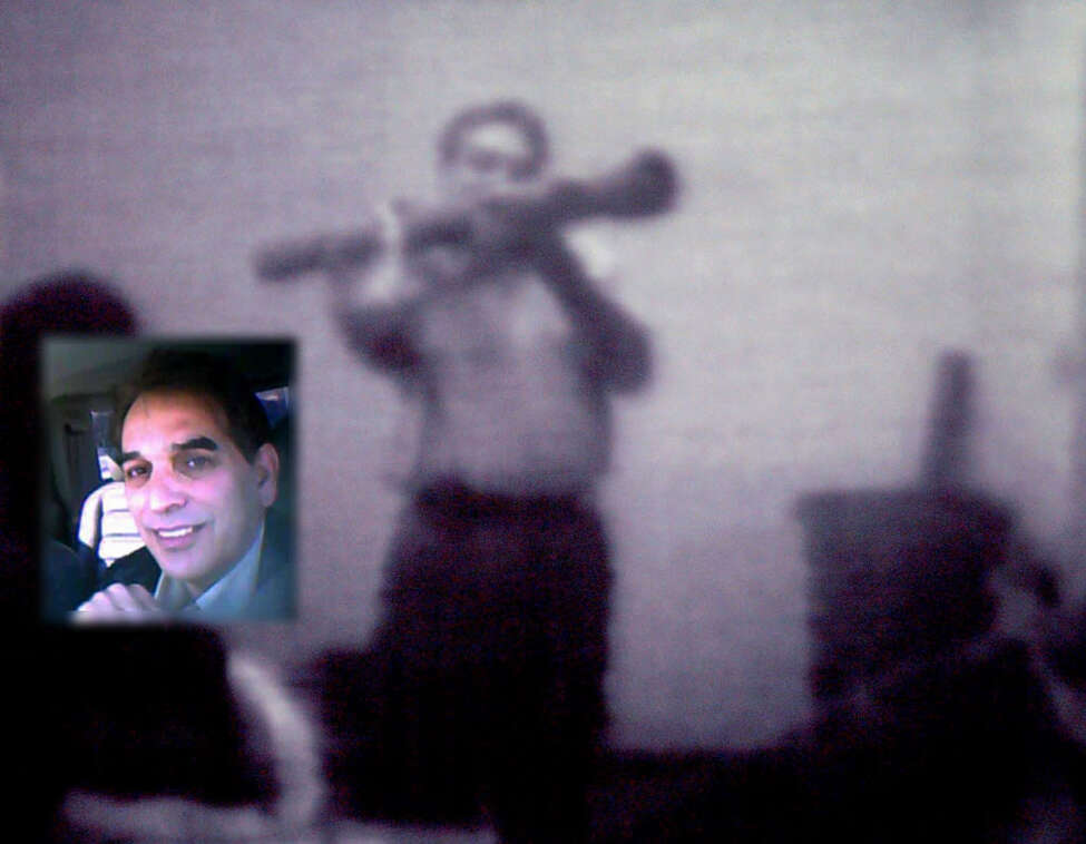 A surveillance videotape shows informant Shahed Hussain wielding an inoperable shoulder-fired rocket launcher to a suspect in a federal terrorism sting in Albany involving Mohammed Hossain and Yassin Aref. Hussain, inset photo, is shown in another surveillance video. (U.S. Attorney's Office / Times Union archive)