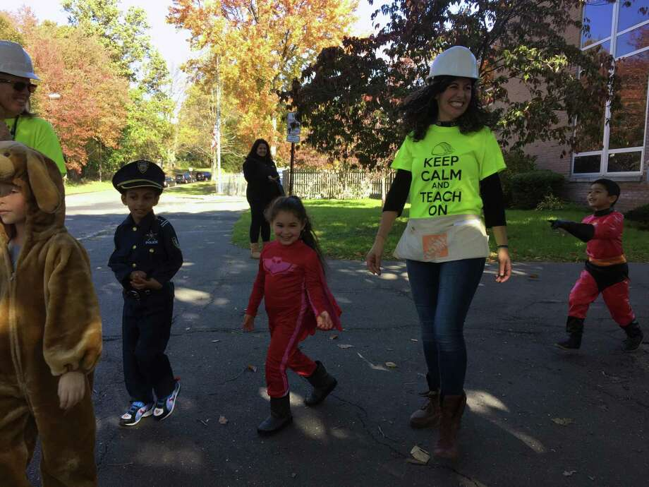 Holland Hill Elementary School students from kindergarten to fifth-grade step out on their annual Halloween Parade, Wednesday, Oct. 31, in Fairfield. The teachers all dressed as construction workers because the school is currently in the middle of a major renovation expected to be completed in 2019. Photo: Contributed /