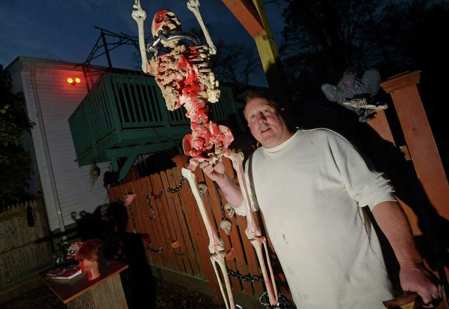 Rich Young at his backyard haunted house Wednesday in Norwalk. Young has hosted a haunted house in his backyard since mvoing into his home at 38 Toilsome Road 7 years ago for the community. Photo: Erik Trautmann / Hearst Connecticut Media / Norwalk Hour
