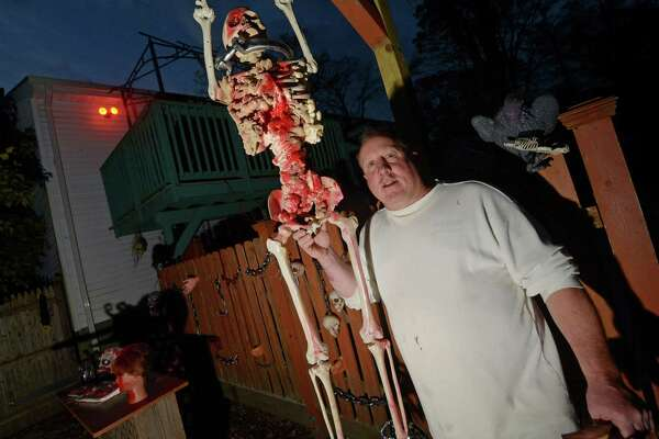 Rich Young at his backyard haunted house Wednesday in Norwalk. Young has hosted a haunted house in his backyard since mvoing into his home at 38 Toilsome Road 7 years ago for the community.