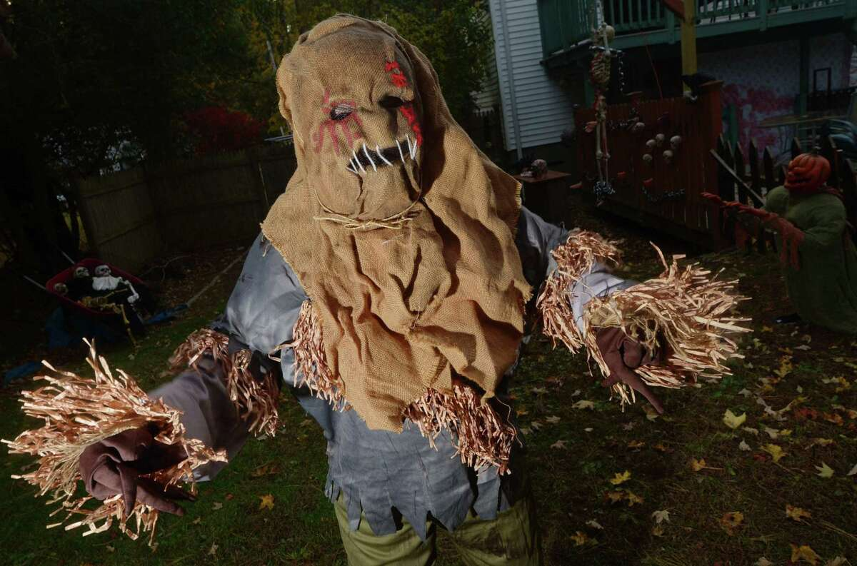 Kathie Young at her backyard haunted house Wednesday, October 31, 2018, in Norwalk, Conn. D'Amore said these typical Halloween festivities bring groups of families and friends together from different households, which goes against public health guidelines.