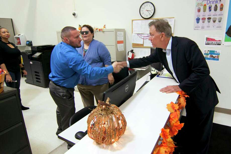 Governor-elect Ned Lamont, right, greets WIC employee David Selawsky after holding a press conference nearby at the Southwest Community Health Center in Bridgeport, Conn., on Saturday, Nov. 1, 2018.  Photo: Christian Abraham, Hearst Connecticut Media / Connecticut Post