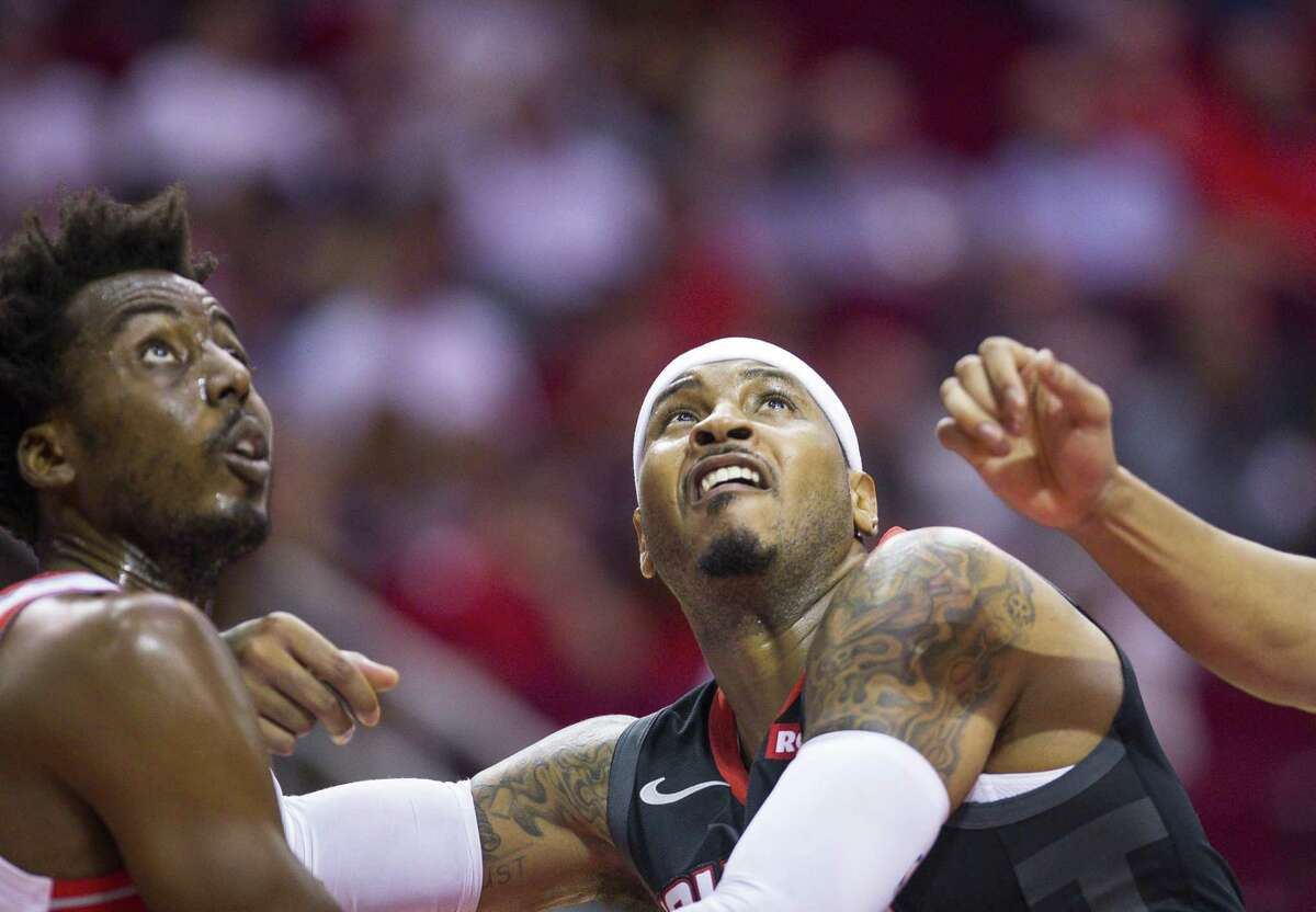 Houston Rockets forward Carmelo Anthony (7) grapples for a rebound with Portland Trail Blazers forward Al-Farouq Aminu (8) during the second half of the Rockets 104-85 loss to the Portland Trail Blazers, Tuesday, Oct. 30, 2018, at Toyota Center in Houston.