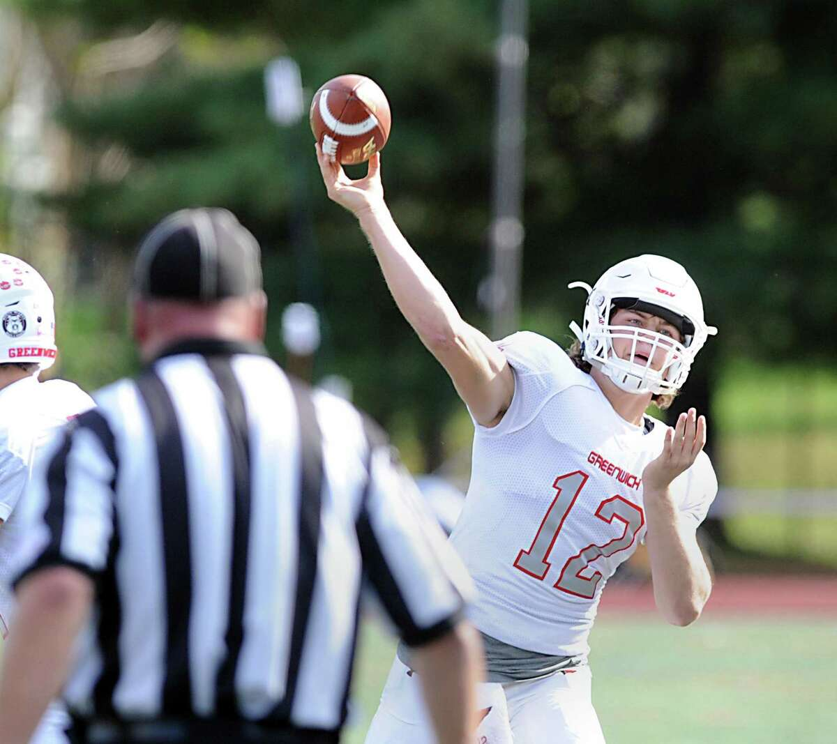 Greenwich quarterback Gavin Muir throws against Westhill on Oct. 20.