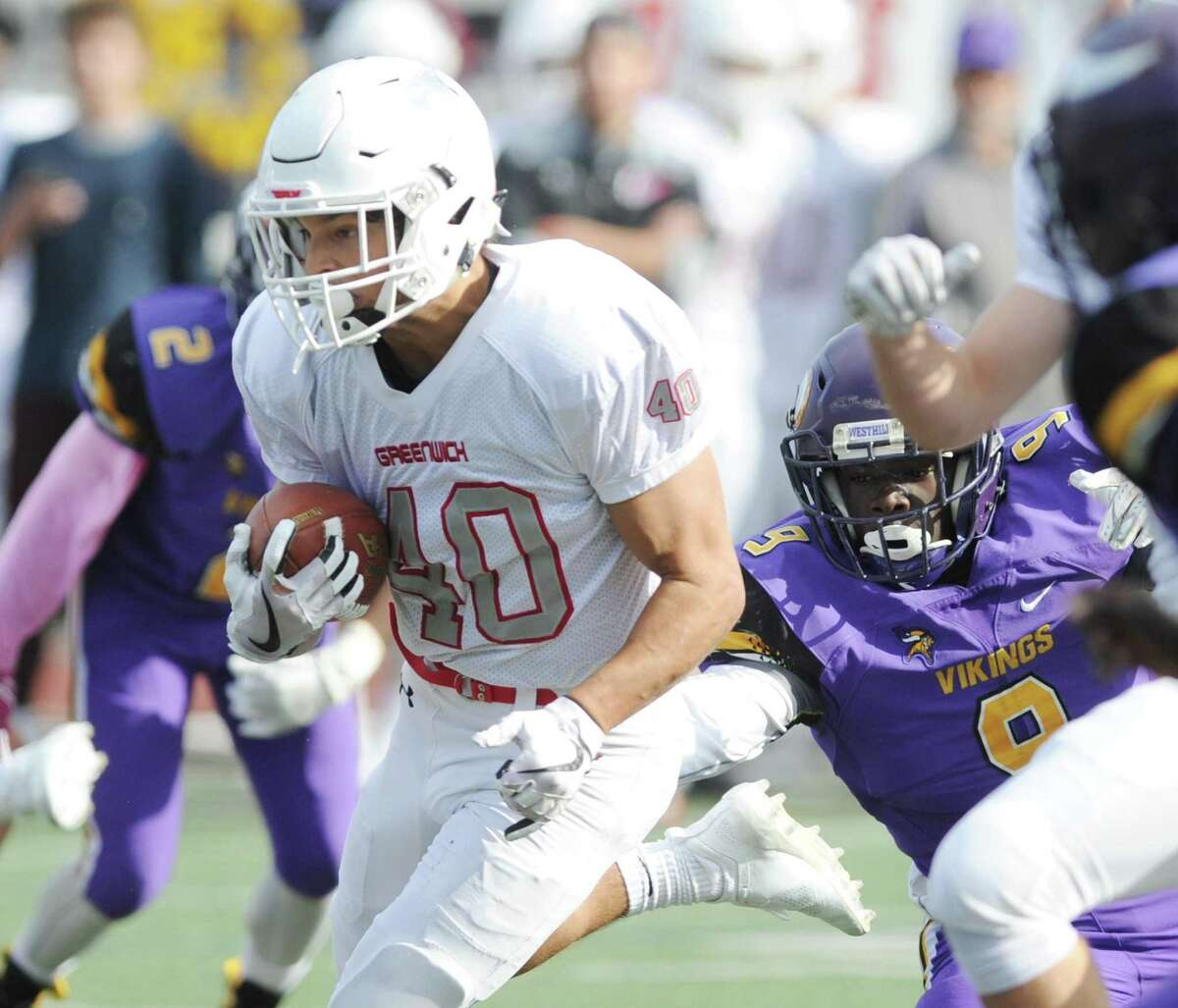 Greenwich's Tysen Comizio runs the ball against Westhill on Oct. 20.