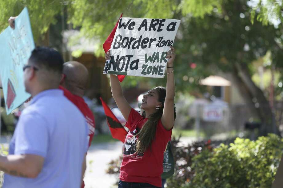 Evon Bueno, 38, joins a protest against the presence of Texas Department of Public Safety troopers and U.S. Border Patrol agents in the Southmost neighborhood of Brownsville on May 25. The department's arrest and other statistics remain suspect. Photo: JERRY LARA /San Antonio Express-News / San Antonio Express-News