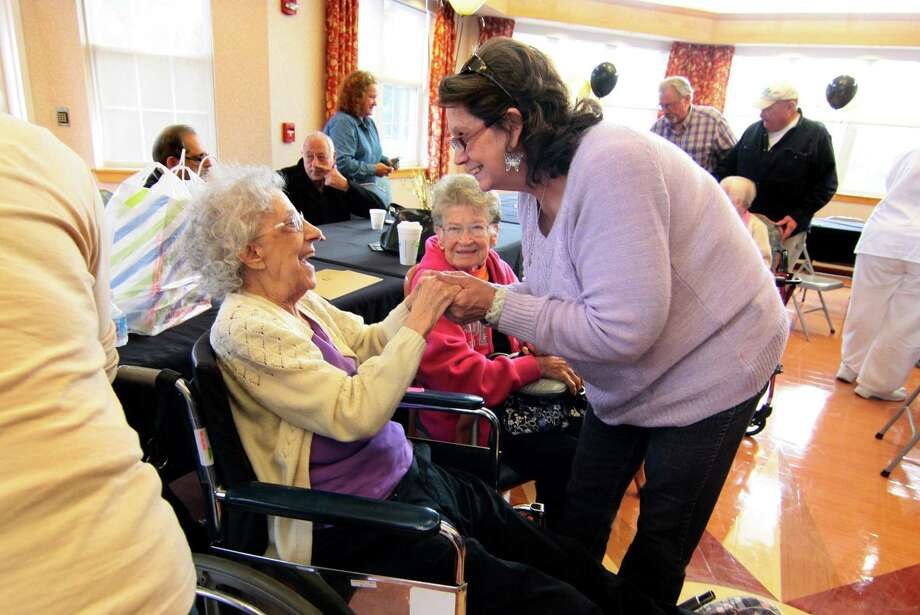 Cathy Rainey, of West Haven, at right, congratulates her friend Rose Daiuto, of Derby, on her103 birthday at a celebration for Daiuto and nine people who are aged 100 to 106 years old at Lord Chamberlain Nursing & Rehabilitation Center in Stratford, Conn., on Wednesday, Oct. 17, 2018. Representatives from the state and the City of Stratford presented proclamations to the residents. Photo: Christian Abraham / Hearst Connecticut Media / Connecticut Post