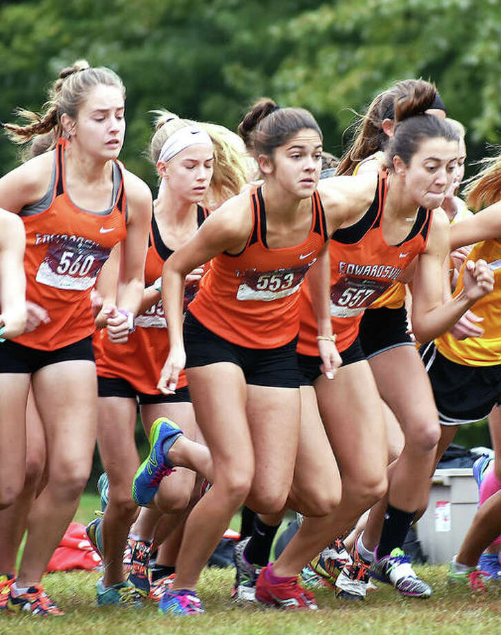 Edwardsville's Hannah Stuart, left, Abby Korak, center, and Maddie Miller take off from the starting line at the Class 3A Quincy Sectional. Photo: Matt Kamp | For The Telegraph