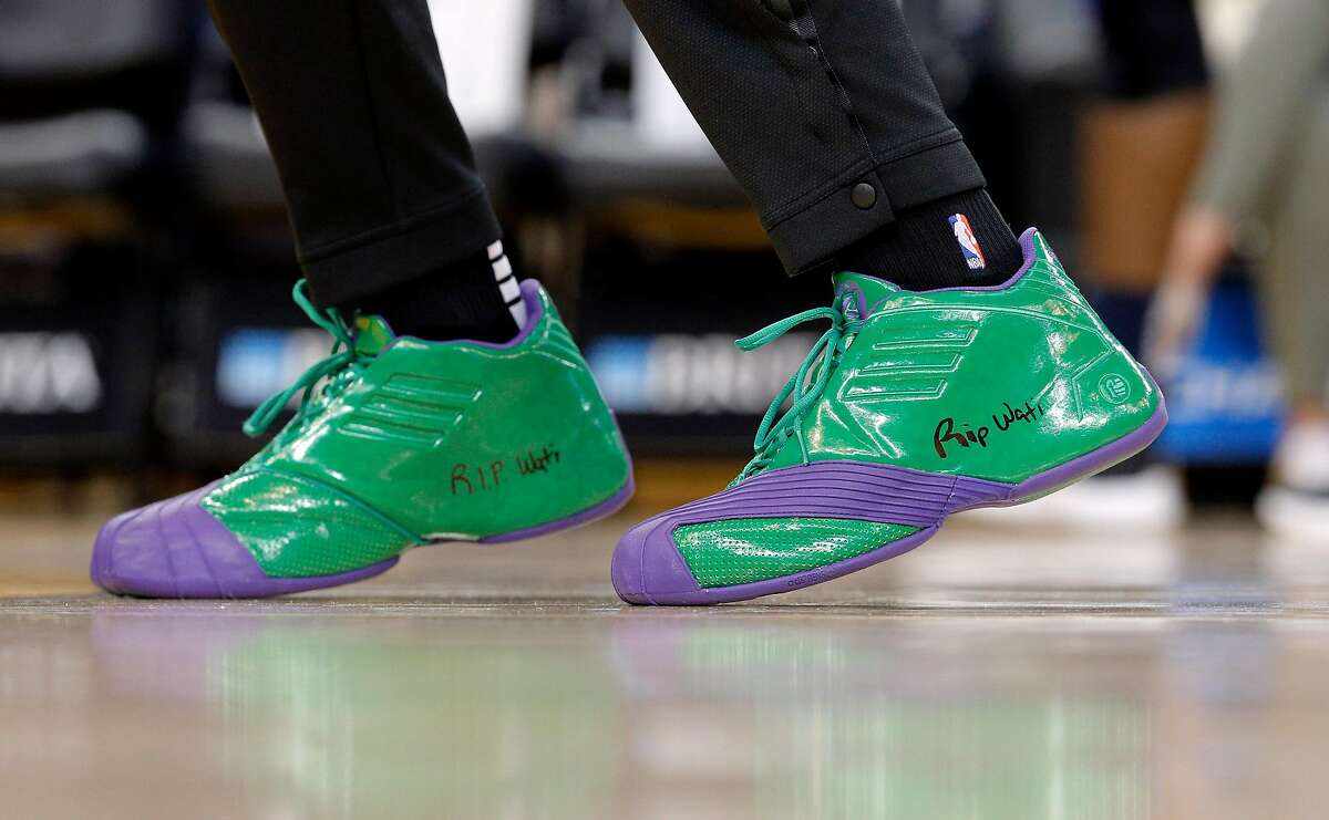 Kevon Looney (5) warms up wearing shoes with an inscription to his childhood friend who passed away before the Golden State Warriors game against the New Orleans Pelicans at Oracle Arena in Oakland, Calif., on Wednesday, October 31, 2018.