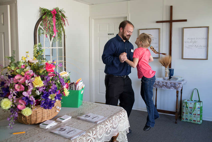 Church remains a large part of life in Sutherland Springs. Five months after the shooting, Evelyn bounces with her dad at the First Baptist Church's temporary sanctuary.