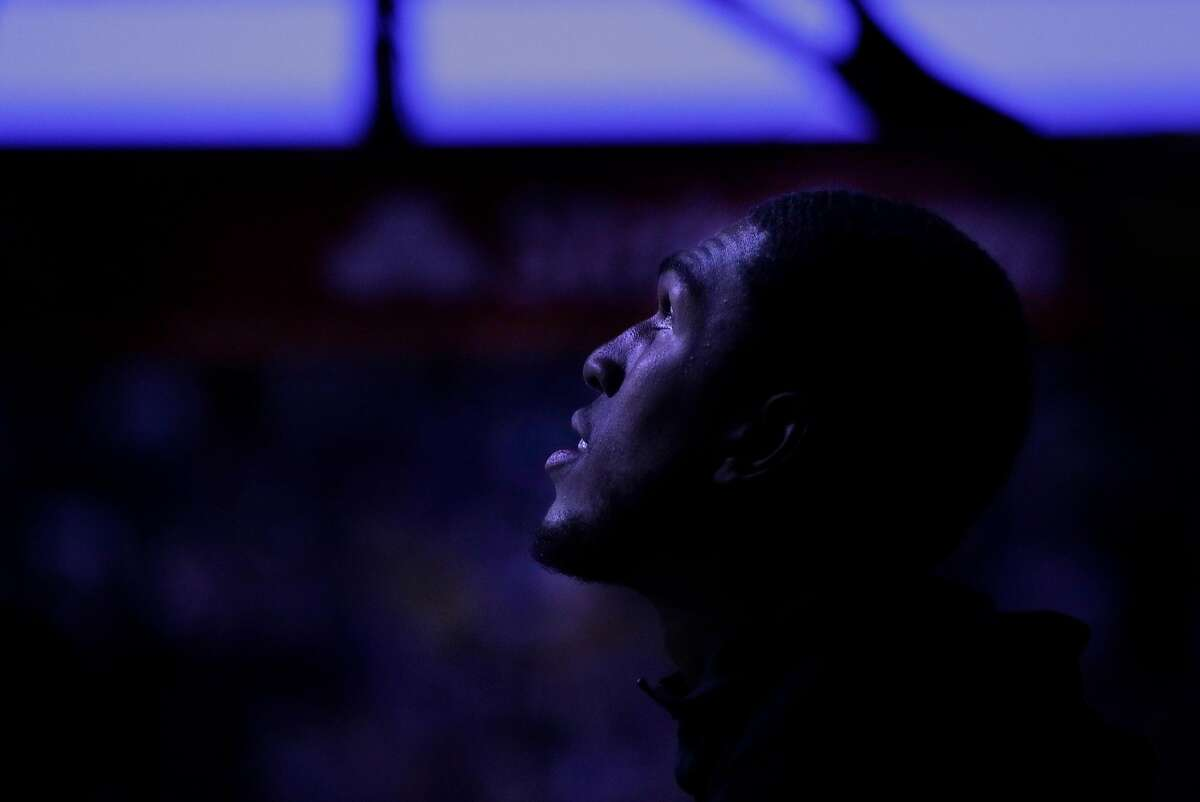 Kevon Looney (5) during introductions before the Golden State Warriors game against the New Orleans Pelicans at Oracle Arena in Oakland, Calif., on Wednesday, October 31, 2018.