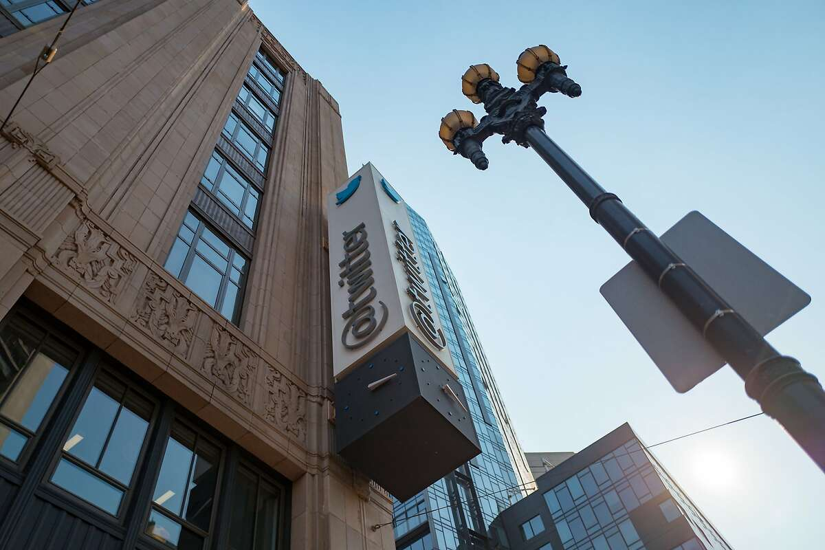 Low-angle view of sign with logo on the facade of the headquarters of social network Twitter in the South of Market (SoMa) neighborhood of San Francisco, California, October 13, 2017. SoMa is known for having one of the highest concentrations of technology companies and startups of any region worldwide. (Photo by Smith Collection/Gado/Getty Images)