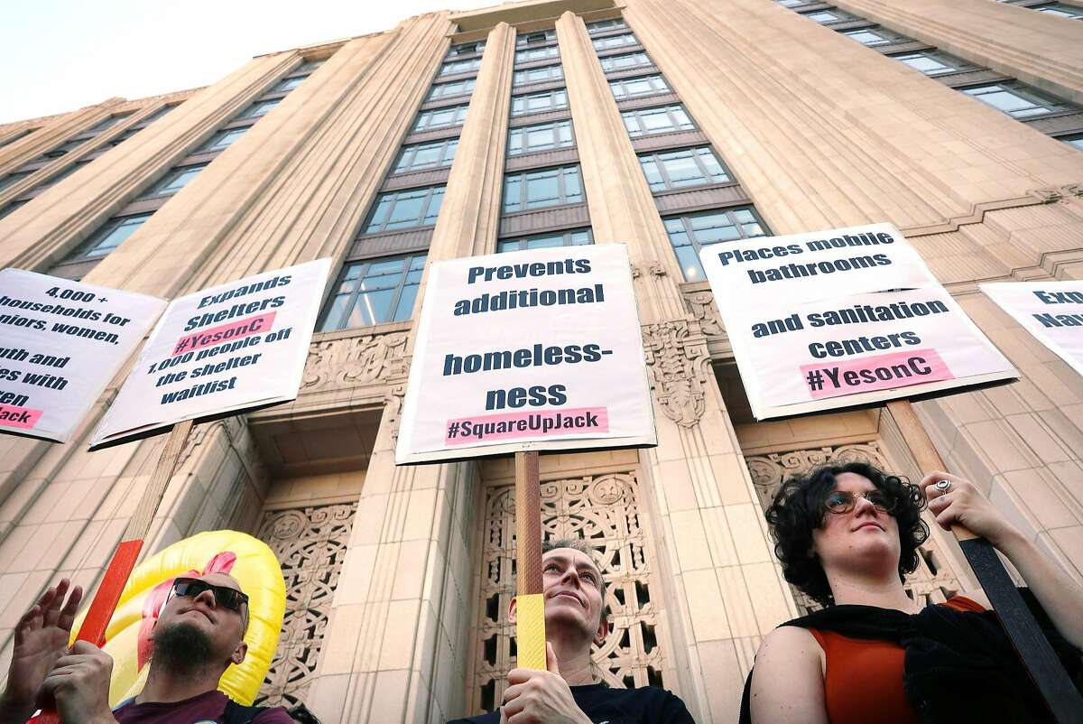 Anakh Sul Rama (l to r), Renee Curran, Emily Garcia and other demonstrators hold signs during a Yes on C rally in front of the entrance to Twitter headquarters on Thursday, October 25, 2018 in San Francisco, Calif.