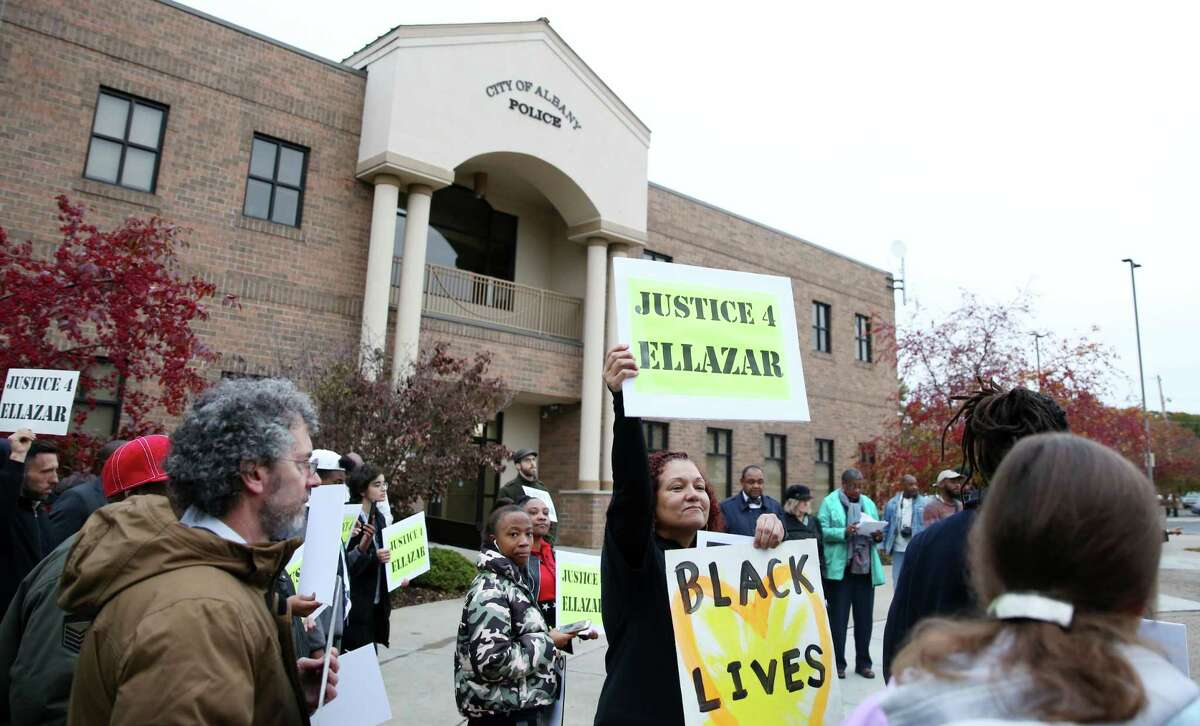 Community members gather during a rally for Ellazar Williams Thursday, Nov. 1, 2018 at the Albany Police Department Headquarters.
