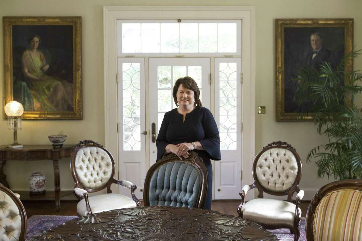 Janelle Sykes became chief financial officer of C.H. Guenther & Son Inc., parent company of Pioneer Flour Mills, in 2003. She was photographed in the Guenther House parlor.