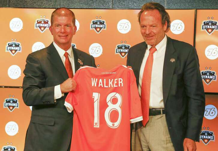 New Dynamo and Dash president John Walker, left, is welcomed to Houston on Thursday by the organization's majority owner, Gabriel Brener.
